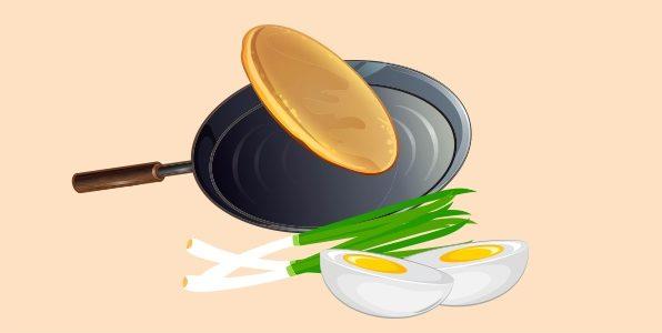 млинці з яйцями та зеленою цибулею